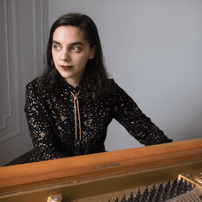 Maria Caputo at a piano